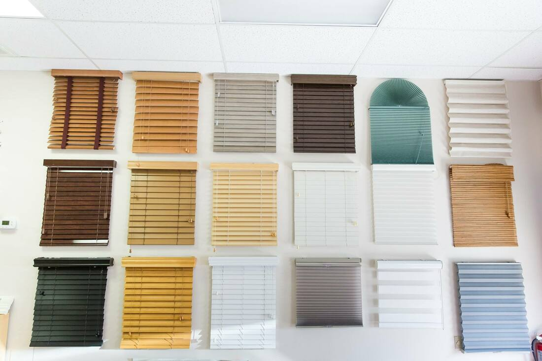 Picture of a wall of sample window coverings in the showroom of Custom Discount Blinds